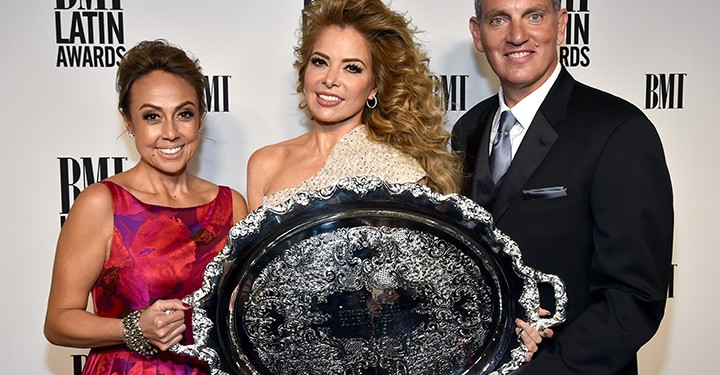 BMI Vice President, Writer/Publisher Relations, Latin Music Delia Orjuela; honoree Gloria Trevi with the 2016 BMI President's Award; and BMI President & CEO Mike O'Neill