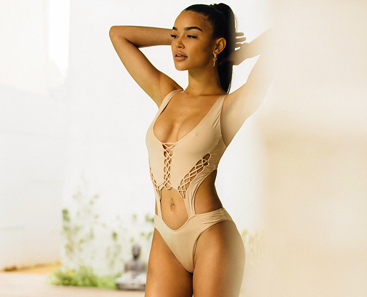 bombshell suit in sand